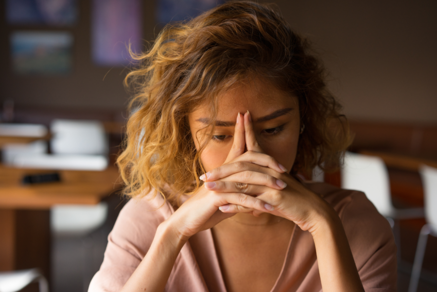 Woman experiencing burnout from money stress.