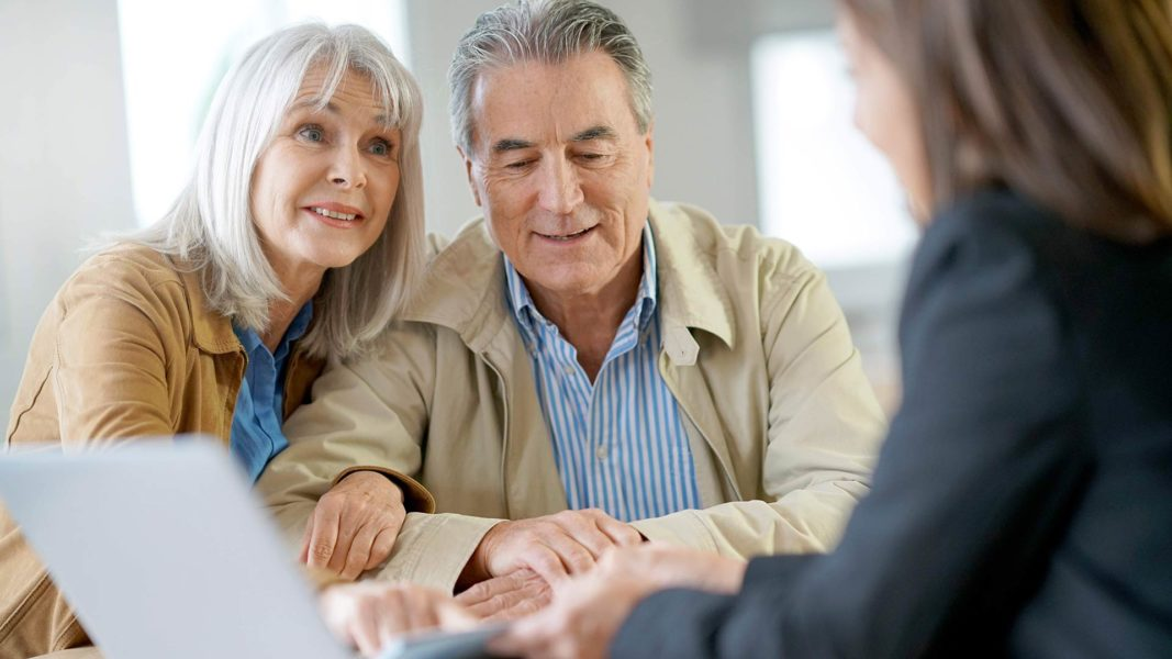 Older couple evaluating debt consolidation options to find a debt solution.