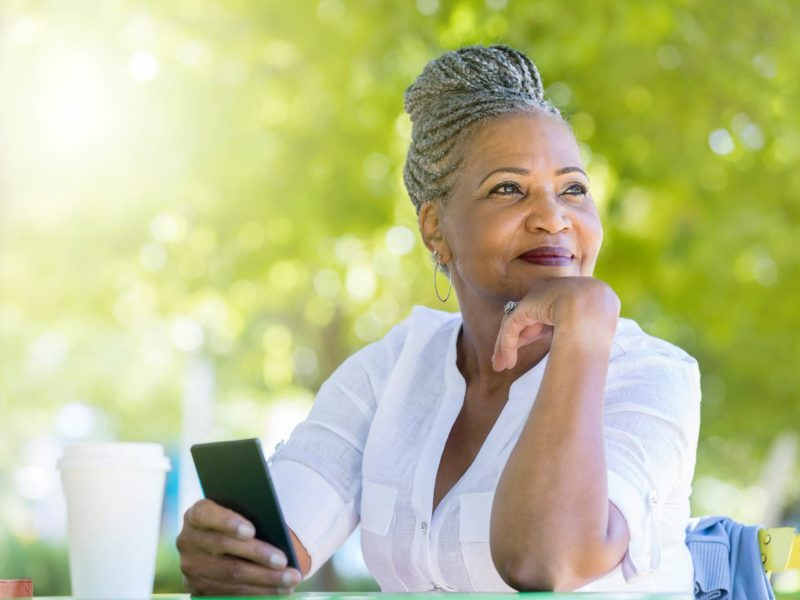 A woman in her sixties is optimistic about her first credit counselling appointment